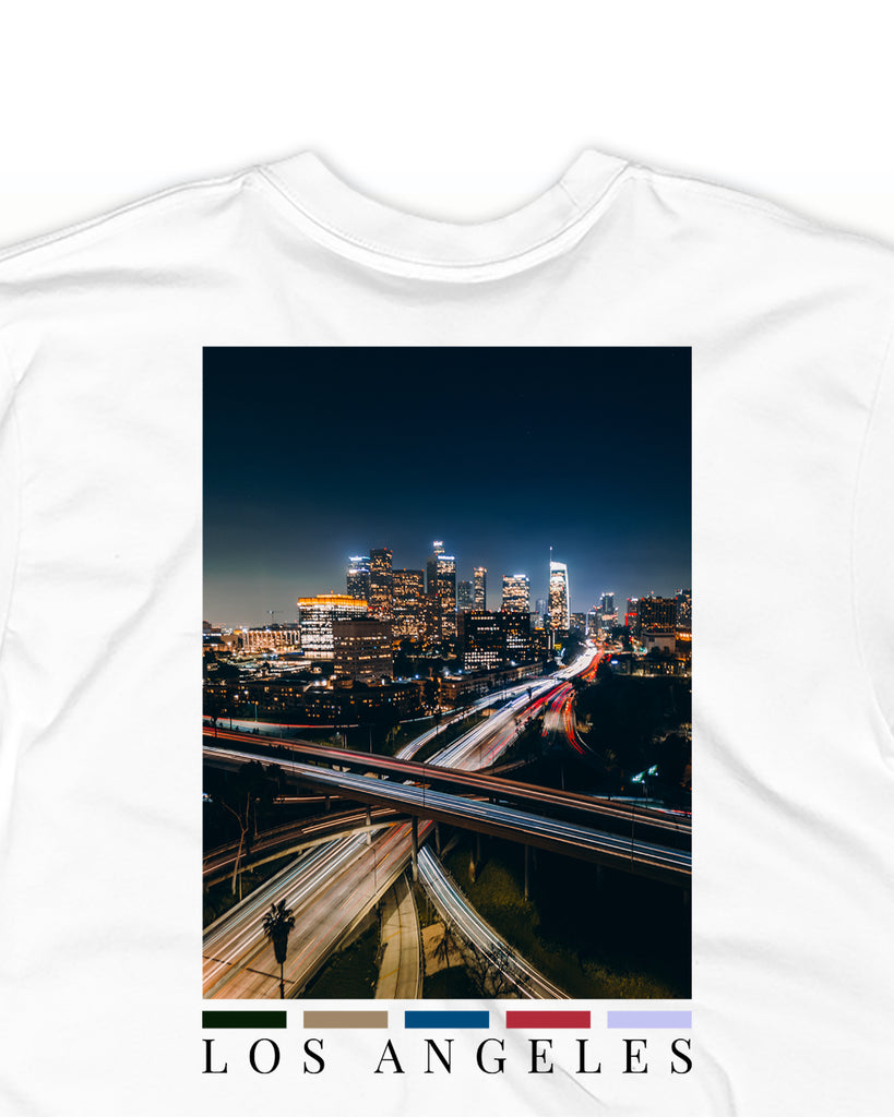 The LA back print t-shirt by nomad creative works featuring a back print of the los angeles city skyline.