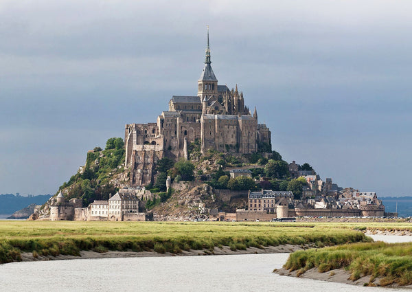 Mont St. Michel, France. Venice, Italy. 11 Cities Frozen in Time You Need to Visit. Travel and Streetwear blog by Nomad New York.