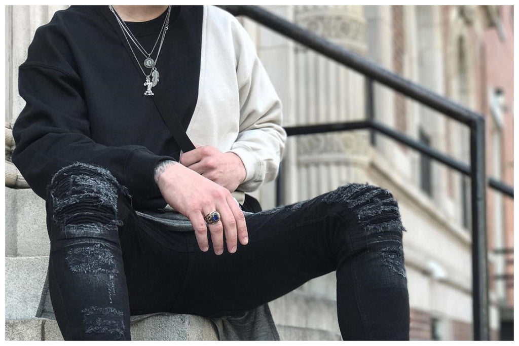 Nicholas Case wearing the Black/Sand color blocked Kane sweatshirt by Nomad New York.