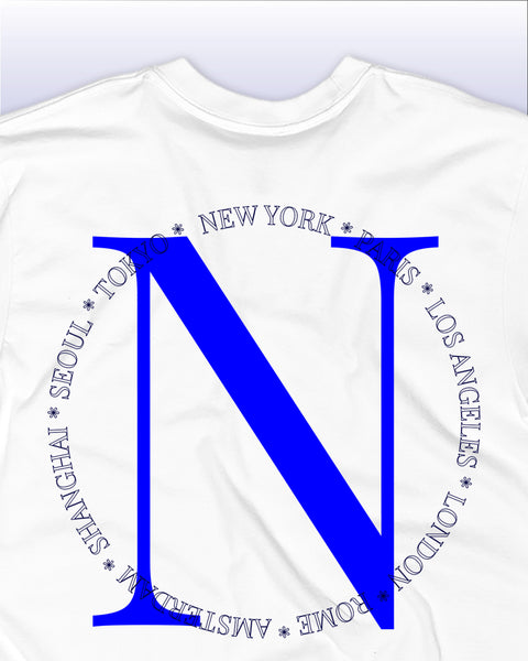 The Nomad Worldwide Tee Close Up Back Detail With World Cities in White and Azure / Sea