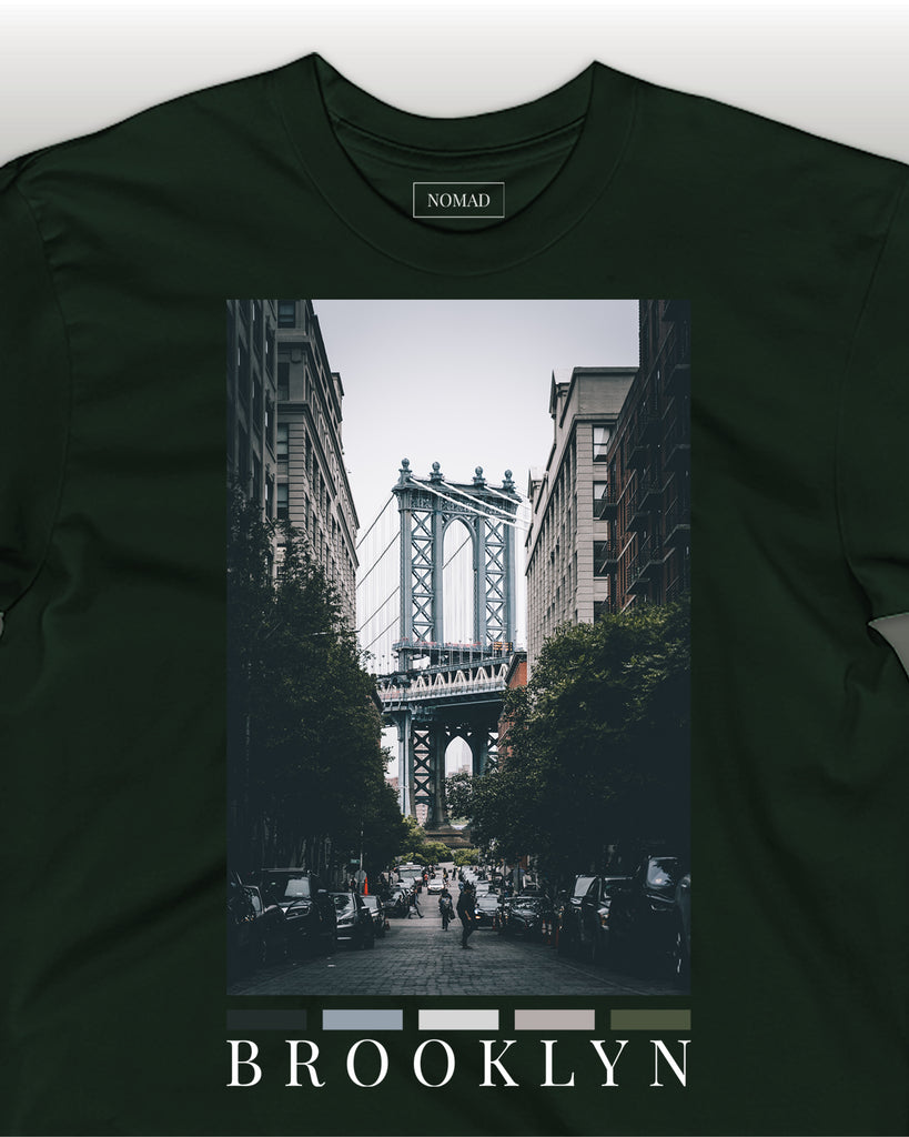 brooklyn front print t-shirt in forest by nomad creative works. Featuring a front print of the manhattan bridge from the brooklyn side.
