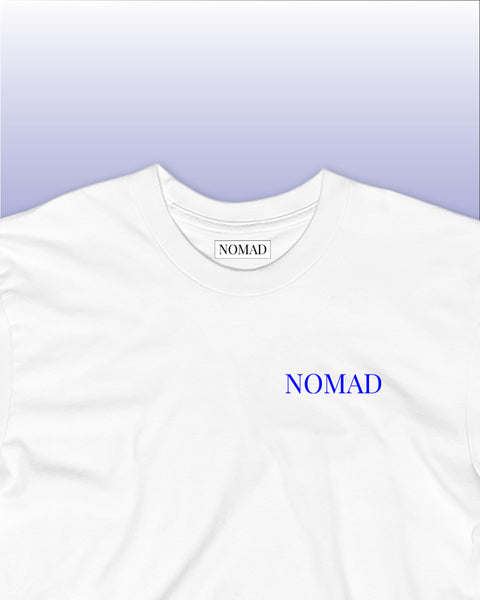 The Nomad Worldwide Tee Front Detail Close Up Picture in White and Azure / Sea