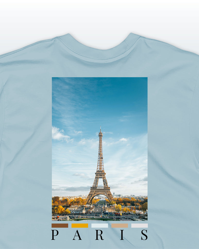 The paris back print t-shirt by nomad creative works in aqua / sky blue, featuring a back print of the eiffel tower and paris skyline.