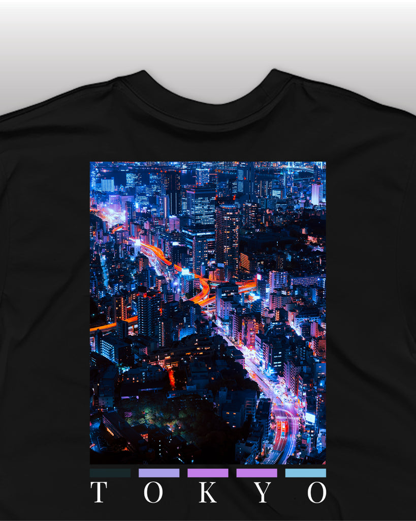 The tokyo back print t-shirt by nomad creative works, featuring a back print of tokyo's famous neon light filled city skyline.