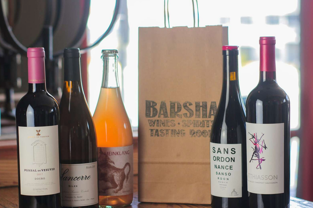 Wine bottles and shopping bag on a counter