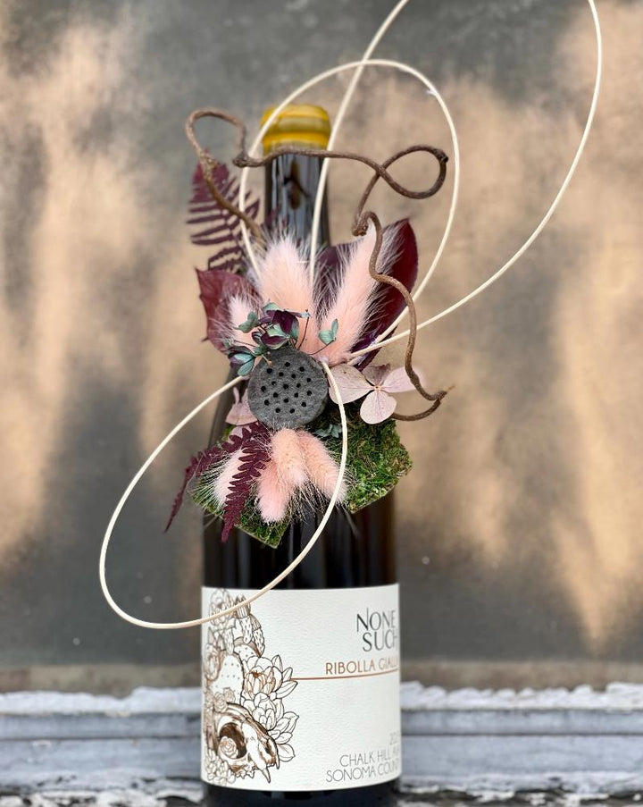 BOTTLE IN PICTURE NOT INCLUDED!  Hand-made dried mini floral tie ons to your wine bottle. Wether in a gift box or on a solo bottle these micro arrangements are stunning!! Also, as opposed to regular wrapping, being dried it can also continue to be enjoyed long after gifting!  Each one will vary as they are all hand-made but we do the best to match each arrangement with the label of the bottle.