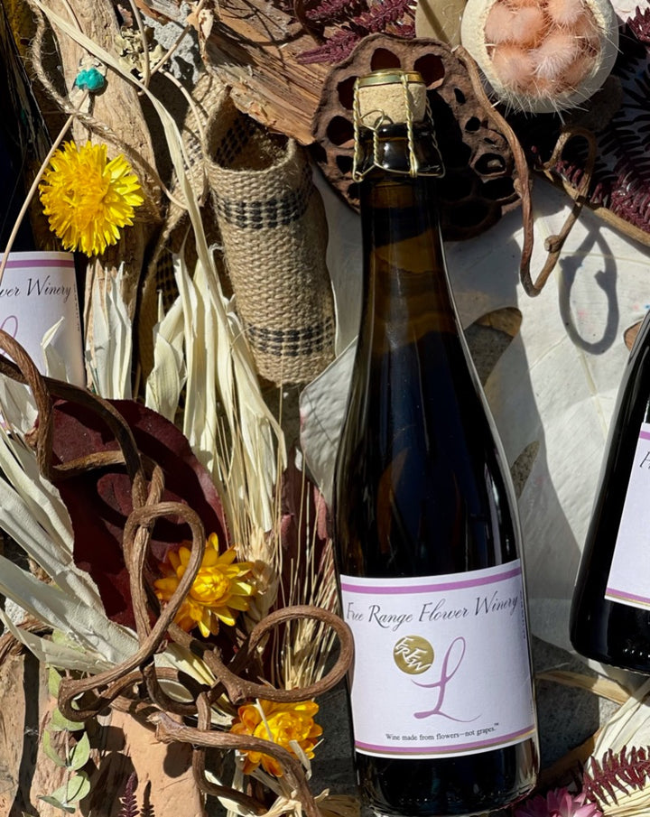 FLOWER WINE! NO GRAPES HERE!  Woman Winemaker Aaliyah Nitoto  100% Violets and Lemon  Super herbaceous with some crazy Eucalyptus vibes. Ever so slightly sweet when the bubble hit your lips. Very limited!