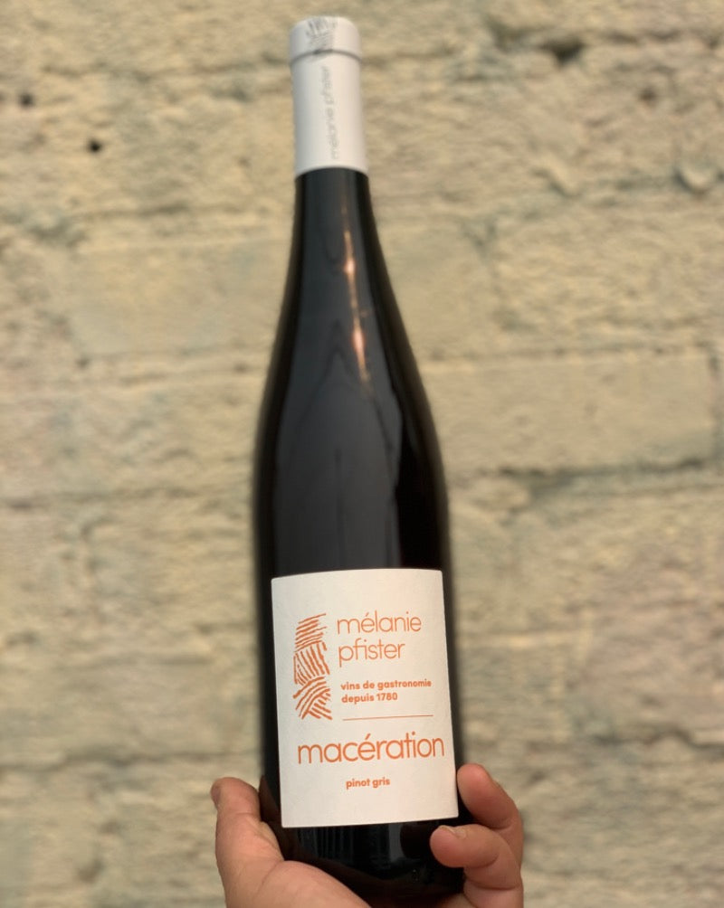 100% Pinot Gris Alsace, France.  Woman winemaker - Mélanie Pfister. All natural. Orange wine. 15 days on skins. Yellow cherries. Rhubarb + sage. Apricots + peach sunsets on a nude beach. Wild strawberries.