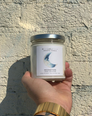 Hidden inside is a Moonstone that increases your intuition and connects you to the moon's energy to inspire new beginnings. Once your candle has burned retrieve your crystal and carry it with you, or place it in a sacred space to bring good fortune within the flow of your life. Hand-poured and made with 100% American farmed soy wax, the natural essential + fragrance oil blend features notes of citrus and sweet fruit. • 9 oz Jar • 50 HR Burn Time