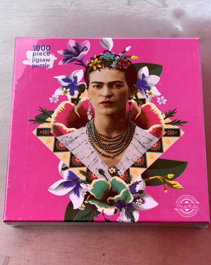 Square-box 1000-piece jigsaw puzzles from Flame Tree, featuring powerful and popular works of art. This new jigsaw will satisfy your need for a challenge, featuring Frida Kahlo Pink. One of the most iconic and important artists of the 20th century, Frida Kahlo's bold, carefully crafted visual identity is in many respects an extension of her art, celebrating her Mexican heritage and countercultural ideals while defying traditional notions of female beauty.