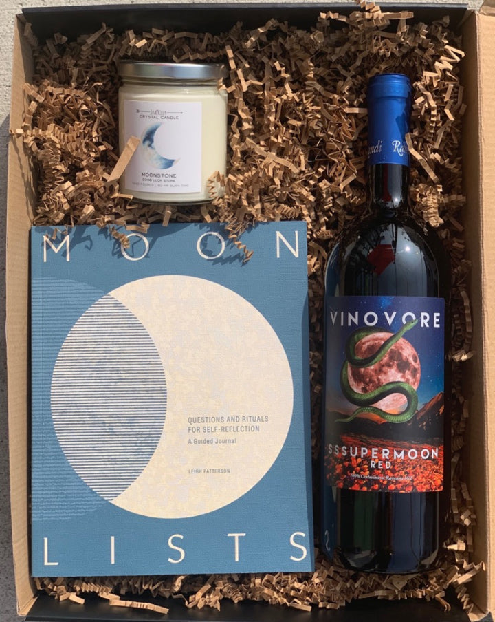 This interactive moon journal, good luck candle and mega tasty bottle of chillable red is the perfect combo for a chill and and meaningful adventure.  This box includes: Jax Kelly Moonstone Candle, Moon List guided journal and Vinovore's Sssupermoon red wine liter.