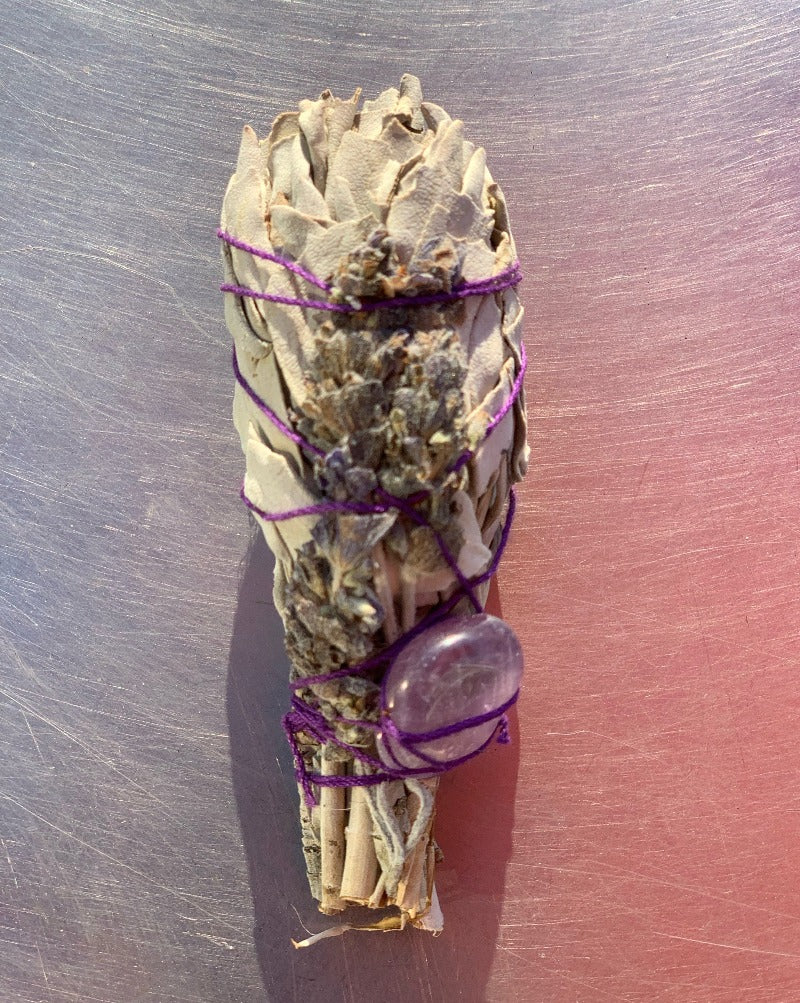 Smudging concept has been around for centuries for cleansing and reenergizing our spiritual senses. When you merge it with the amazing Lavender's purifying agents, your extrasensory perceptions are enhanced to embrace contentment without doubts. Bring home the floral potency mergence with sage benefits with decorated vitality.