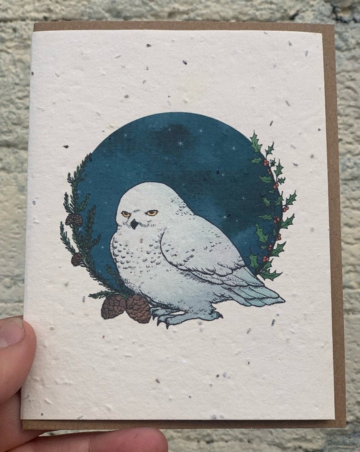 "Winter Snowy Owl Greeting Cards - Plantable Seed Paper. These greeting cards feature pen and watercolor drawings. These cards are printed on plantable post-consumer paper, which is embedded with wildflower seeds. To plant the paper, cover it with 1/8"" of soil in full to partial sun and keep moist until the seeds establish. The seeds include Bird's Eye, Clarkia, Black Eyed Susan, Sweet Alyssum, Catchfly and Snapdragon."