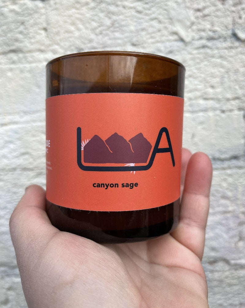LA Original candles help support women in need celebrate the geographic diversity and beauty of this great city:  Canyon Sage: Experience the calming fragrance of desert cactus flowers and sage nestled in warm hints of citrus.