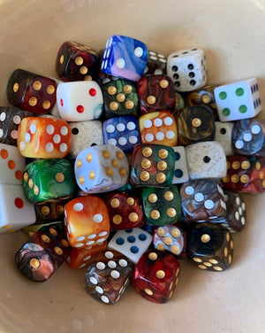 Assorted dice... die? Either way, you get two! If you a have a color preference specify it in the message section at checkout and we'll do our best to accommodate!
