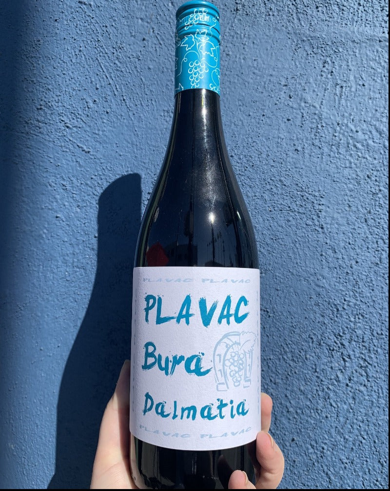 100% Plavac Mali Dalmatia, Croatia.  Woman winemaker - Antonia Mrgudić. All natural. Chilled red  Bright & vivacious. Black currant + dust. Like a bouncy house of minerals and fruit jumping in your mouth. Raspberry tabacco. Spice and cloves.