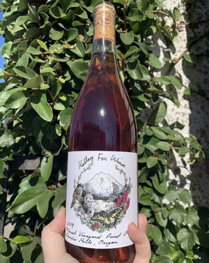 100% Pinot Gris. Dundee Hills, Oregon.  Woman winemaker - Kelley Fox. All natural. 18 days on the skins. Dewy rose petal on magical and misty alpine hills. Watermelon rind. Vibrant & funky. Dry jolly rancher. Cherry tomato. Beets & basil.