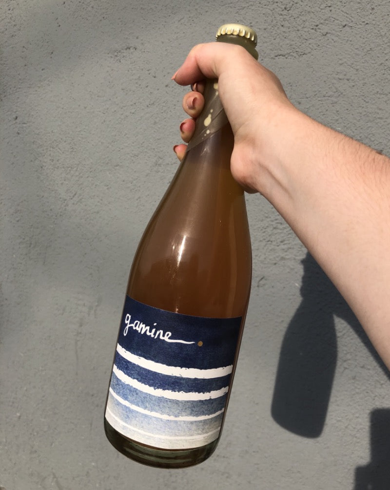 100% Grenache Pét-Nat Applegate Valley, Washington.  Woman winemaker - Kate Norris. All natural. Apéro-perfect bubbly action. Mouthwatering. Slate + white peach. Almond blossom. Apricot skin. Pour some pét-nat on me!