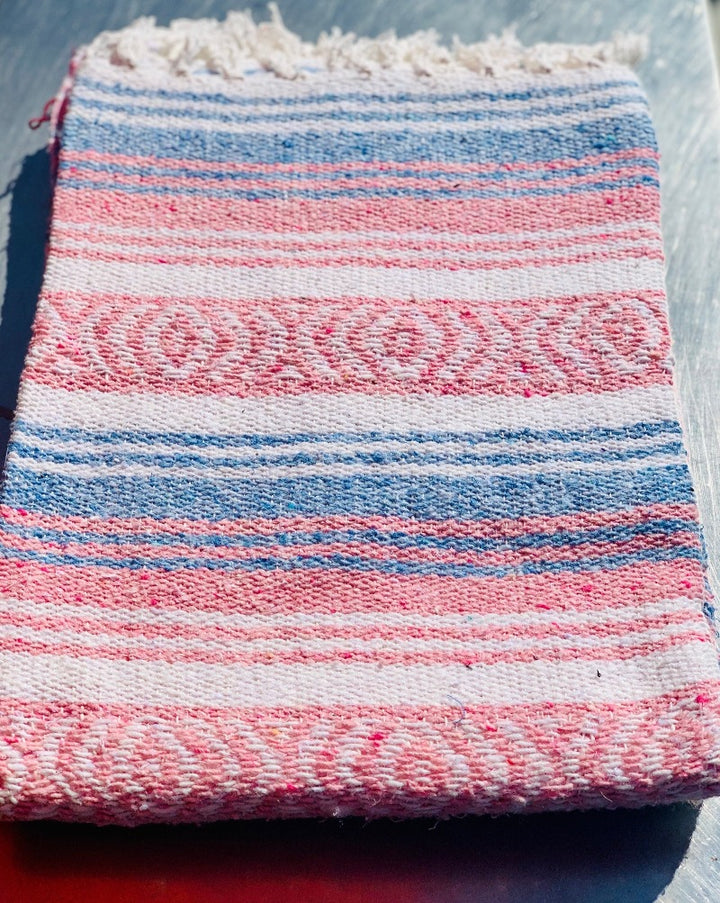 "Measure 74"" x 48"" Colors:  Light Blue Light Pink White & White Fringe detail on two ends Soft blend of cotton, acrylic and polyester Washes well in cold cycle and recommended to air dry Perfect as your favorite couch or bed throw, picnics, concerts, and the beach."