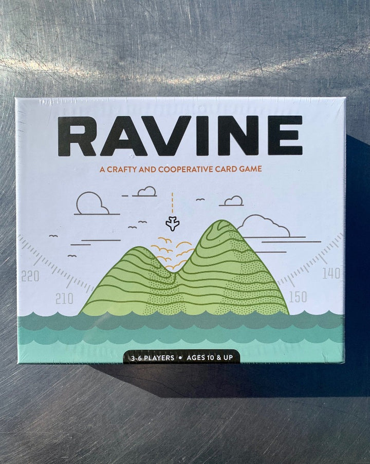 Ravine is a strategic and cooperative survival card game. You and your friends survived the plane crash, but will you survive the night? Work together to forage for food, craft a fire, and build shelters, but be wary: every step you take in the ravine could be one step closer to madness. 3-6 PLAYERS | AGES 12+ | 20 MINUTES.