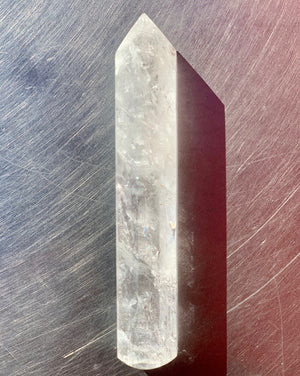Clear Quartz crystal is one of the purest examples and is considered to be the light bringer. It's an amazing amplifying stone, meaning that whatever you pour into it, will pour out tenfold. The clarity of its many faces can spark memory, hone concentration, and bring your whole being back to balance.