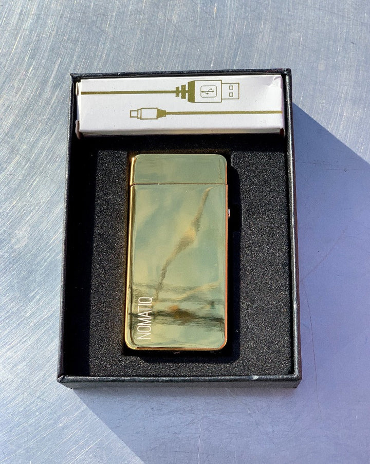 Golden Dual Arc (Electric) Lighter (comes with USB charger) -Rechargeable via USB connection on bottom. Super green way to light all your fires in your life!