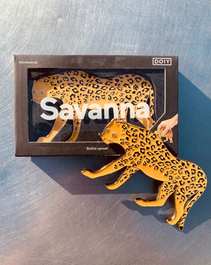 Fashionable enameled metal bottle opener shaped as a cheetah.