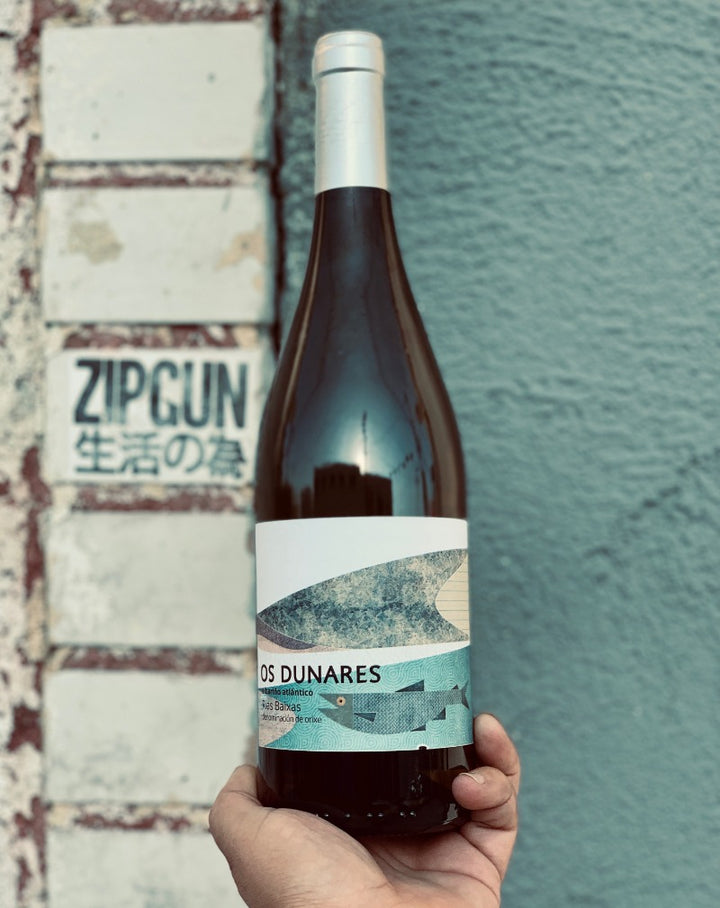 100% Albariño. Rías Baixas, Spain.  Woman winemaker - Chris Yagüe. All natural. Dried Hay. Queer made. 120 year old vines. Salty like a smack of sea air in your mouth. This wine has bananas B-A-N-A-N-A-S