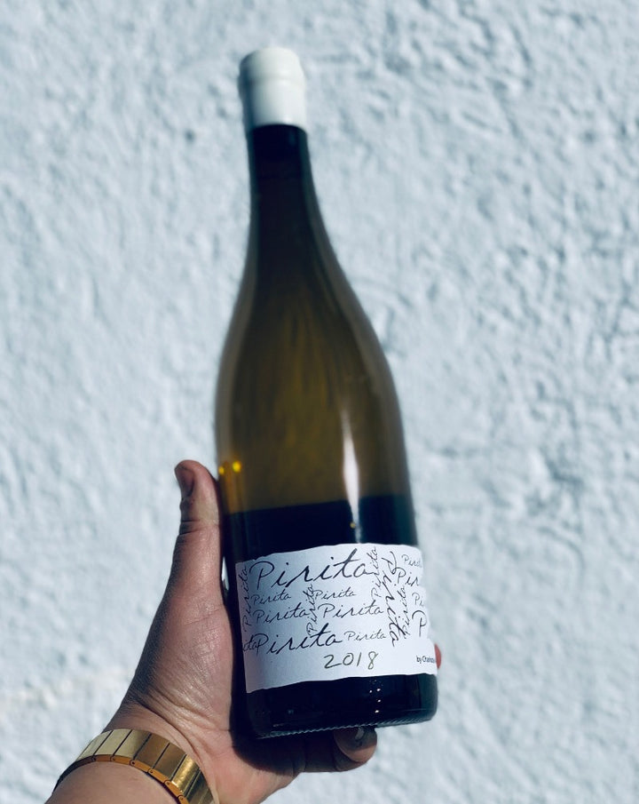 100% Doña Blanc (Malvasia). Zamora, Spain.  Lady winemaker - Charlotte Allen. All natural. Funky, creamy, fresh + complex. Violets + licorice. Herbal + mineral. Slightly salty. Dry banana vibes. Wine-baby orange snow globe.