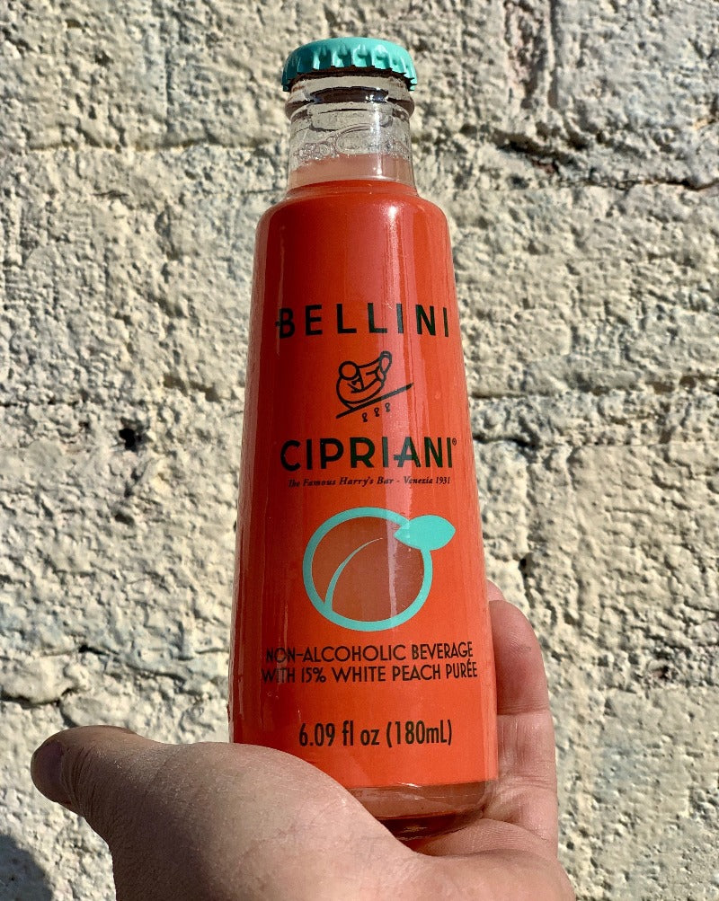 This non-alcoholic Bellini mixer is made with white peach puree and mineral water. Perfect to drink alone, or mix with prosecco for the classic Bellini invented 80 years ago by Cipriani at Harry's Bar in Venice. 6.09 oz. Made in Italy.