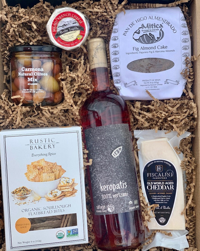 A box of artisanal crackers, 2 different kinds of cheese, a fig almond cake and mixed olives to complete the cheese feast! So, simply choose your color, and we will do the pairing for you!!