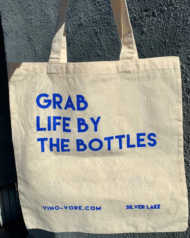 Grab Life By The Bottles with our super cutesy tote bag! 100% cotton.