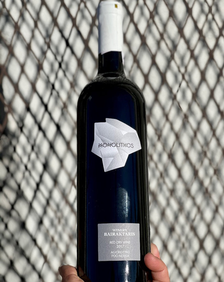 100% Ariorgitiko. Nemea, Greece.  Woman winemaker - Adamantia Bairaktaris. All natural. Chillable red. Greek Nouveau. Banging cherries. Dry + bursting at the seam with supple silkiness. Leafy mushrooms. Roasted spices.
