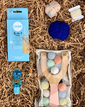 This box already includes: 5-in-1 mini loom tool, two balls of yarn (colors vary), a Little Lark Sling Shot with pastel-felt amo and an acrylic ring pop wine stopper. SO YOU SIMPLY: Buy this box. Buy a bottle of wine from any on the site. Add an optional gift message on the cart page.