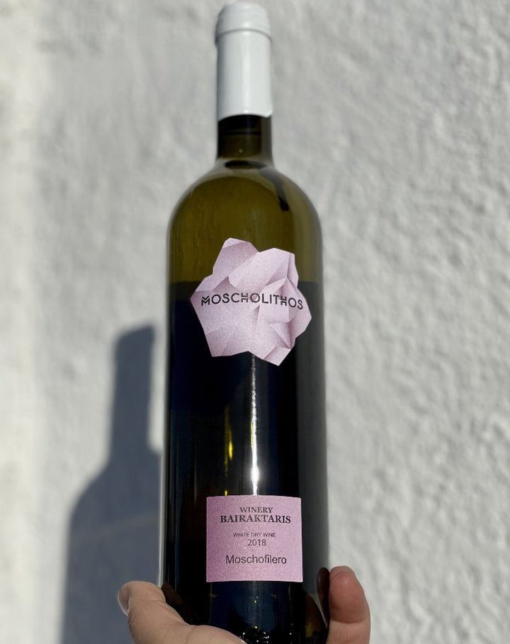 100% Moschofilero. Nemea, Greece.  Woman winemaker - Adamantia Bairaktaris. All natural. Lemon head crunch with a meringue whip. A magical wine nymph in a peach bikini diving into a sea of salty pineapple froth. Dry + gulpable.