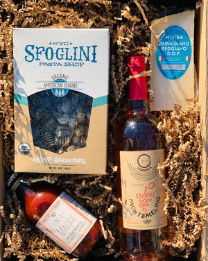 The gift of food and wine is always a hit! This tasty box has Apulian tomato and basil sauce made in Italy, Sfoglini organic hemp pasta, aged Italian Parmesan and a bottle of wine the color of your choice that we will pair with the meal! So, simply choose your color, and we will do the rest!  *** SOME PRODUCTS SHOWN ARE FOR EXAMPLE ONLY!