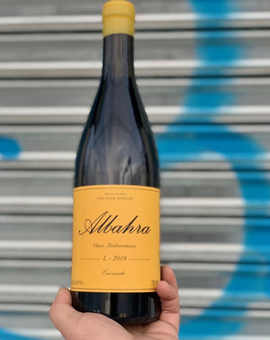 Grenacha Tintorea. Canary Islands, Spain.  Woman winemaker - Laura Ramos. All natural. Super allocated + low production. Savory + succulent. WILF - Wine I'd like to F##k Rich + juicy with banging acidity. Pepper + plums Wispy tannins.