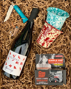 Take a stroll and snap some wild pics with this reusable film camera, then set up camp with your trusty Opinel knife and Crow Canyon tumblers for a drink break! Simply choose your wine color, and we will do the rest!  This box includes: two assorted colored enamel Crow Canyon tumblers, a Lomography single use camera an Opinel knife and a wine - color of your choice!  ***WINE AND SOME ITEMS SHOWN ARE FOR EXAMPLE ONLY***