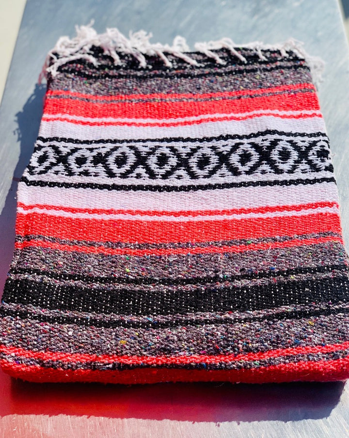 "Measure 74"" x 48"" Colors: Coral, White, Grey & White Fringe detail on two ends Soft blend of cotton, acrylic and polyester Washes well in cold cycle and recommended to air dry Perfect as your favorite couch or bed throw, picnics, concerts, and the beach."