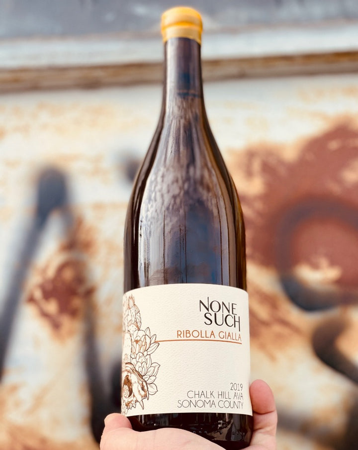 100% Ribolla Gialla. Sonoma, California.  Woman winemaker - Caitlin Quinn. All natural. Only 2 barrels were made! She's delicate and beautiful yet rich and complex with a little salty bite, I'd date (drink) her!! Chamomile custard with a fresh lemon and mineral glaze.