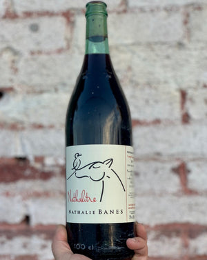 100% Gamay Beaujolais, France.  Woman winemaker - Nathalie Banes. All natural. Chillable red. Brilliant crushed rocky, gravel stone minerality. Cranberries + chalk. Green olives and horse sweat. Peppery spritz. 1 liter (bottle + 1/2)