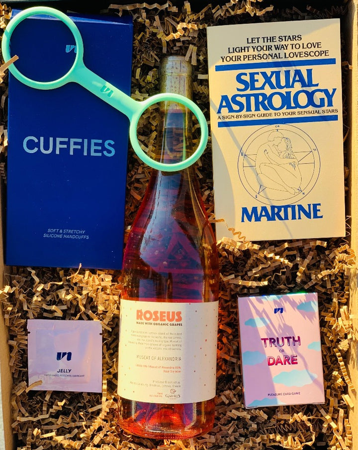 Time for a little exploration! This Box has all the goods with Unbound Silicone Handcuffs, Truth or Dare sexy card game, Sexual Astrology book, natural lube packet and of course a bottle of wine, color of your choice! So, simply choose your color, and we will do the rest!  ***WINE SHOWN IS FOR EXAMPLE ONLY!
