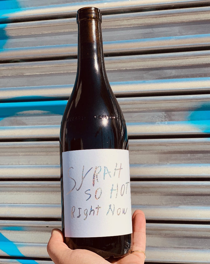100%  Carbonic Syrah Santa Barbara, California.  Woman vintner - Maria Soloranzo, Jessica Stolpman. All natural. A piercing hot sexy raspberry gaze from across the room. Crackling spice. A peppery pop. Electric energy pumping wine minerals, earth, bramble + olives through you...so hot!!