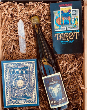 I see a lot of good wine in your future! This mystical box has a deck of Illuminated Tarot cards, a Complete Guide to Tarot book, a crystal wand and of course a bottle of wine, color of your choice! So, simply choose your color, and we will do the rest!  ***SOME PRODUCTS SHOWN ARE FOR EXAMPLE ONLY!