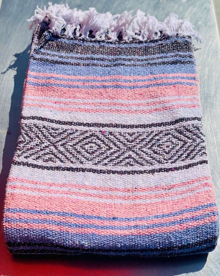 "Measure 74"" x 48"" Colors:  Light Blue Light Pink Grey & White Fringe detail on two ends Soft blend of cotton, acrylic and polyester Washes well in cold cycle and recommended to air dry Perfect as your favorite couch or bed throw, picnics, concerts, and the beach."