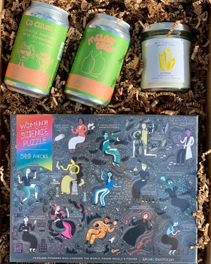 Whether you are kickin' by yourself or held up with others, this box will def make time pass with some quality inspiration!  This box includes: Fun Puzzle, Jax Kelly Citrine Success Candle and two cans (= one full wine bottle) of Zafa's Co Cellar Wine and Cider cans .  Buy this box. Add an optional gift message on the cart page.