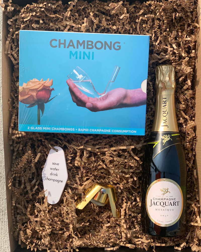 Who doesn't love bubbles! We've complied these sweet gift items, plus this delicious bottle of Tarlant Champagne, the perfect gift for any champagne-lover out there.  This box includes: Drink champagne key chain, gold bottle stopper, mini Chambong, and Tarlant Champagne.  Buy this box. Add an optional gift message on the cart page.