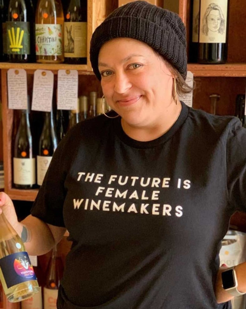 "Vinovore's own ""The Future Is Female Winemakers"" t shirt. Text on front with logo on back. Black tee with white print. Unisex."