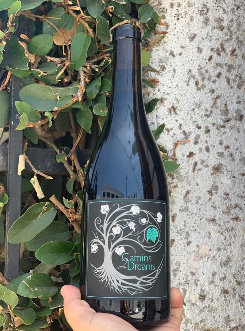 100% Syrah Santa Rita Hills, California.  Woman winemakers - Mireia Taribó + Tara Gomez. All natural. Wife and Wife! Queer made! Native American winemaker. Spicy and meaty.  Pepper and silk. Black olives. Squid ink and earth. Crushed blackberries.
