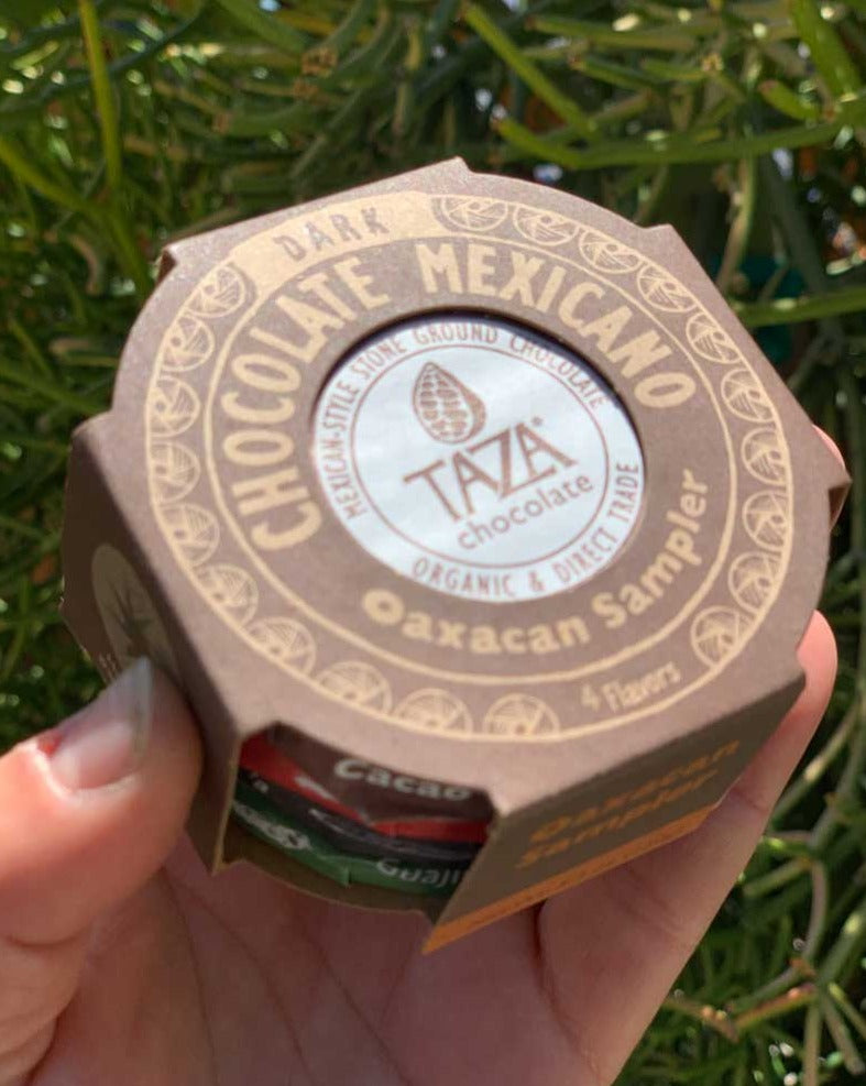 Four traditional Oaxacan-inspired flavors of our perfectly unrefined Chocolate Mexicano discs are tucked into a unique cut-out gift box. Sample and share stone ground chocolate with true grit!  Contains 4 x 1.35 oz Chocolate Mexicano Discs: Guajillo Chili, Cacao Puro, Cinnamon, and Vanilla.